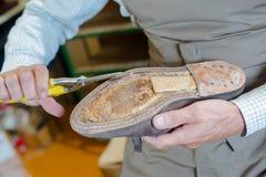 Shoe maker preparing shoe Royalty Free Stock Photo
