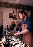 Shoe maker in workshop. Royalty Free Stock Photo