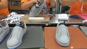 Shoe making factory stock video footage