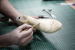 Shoe making project. Drawing a shoe model. Shoe maker creating a design of a new shoe Royalty Free Stock Image