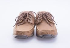 Shoe or male brown leather shoes on a background. Stock Image