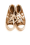 Shoe memories. Old shoes are on white background in sepia tone Royalty Free Stock Photo