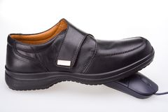 Shoe and Mouse. Black shoe and black mouse royalty free stock photos