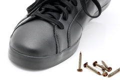 Shoe and nails. Stock Photos