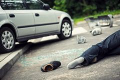 Shoe next to a victim of fatal car accident on the road. Concept photo royalty free stock photography