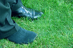Shoe on the other foot. Business pants with one shoe off royalty free stock photo