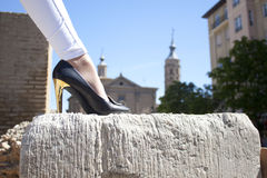 Shoe over a stone in front of a church Stock Photo