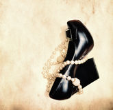Shoe and pearl necklace Royalty Free Stock Photo