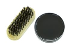 Shoe polish in Black color with a shoe brush Royalty Free Stock Image