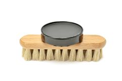 Shoe polish and brush Royalty Free Stock Photo