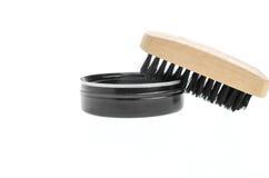 Shoe polish and brush on white Stock Images