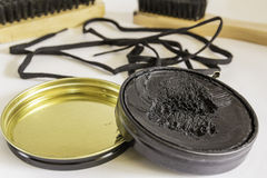 Shoe Polish and Brushes. A display of Shoe Polish, Laces and Brushes Stock Images