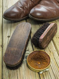 Shoe polish and old shoes Stock Photography