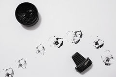 Shoe polish stains on the black ink on white paper Royalty Free Stock Images