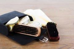 Shoe polishig equipment on a wooden floor Royalty Free Stock Photo