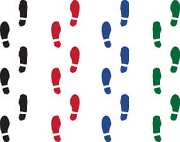 Shoe Print Colors. Various colored shoe prints.  Black, red, green and blue Stock Photos