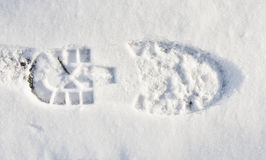 Shoe print in fresh snow. At daytime Royalty Free Stock Photography
