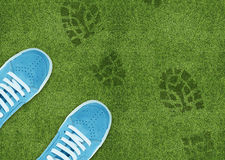 Shoe print on green grassland. Blue Shoe print on green grassland Stock Photos