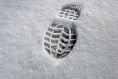 A shoe print. Made in snow Stock Images