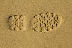 Shoe print in the sand Stock Image