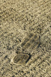 Shoe print in sand Stock Image