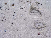 Shoe print on sand at the beach Stock Photo