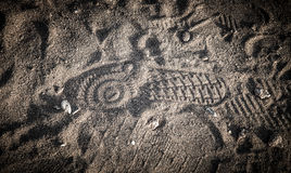 Shoe print in the sand with shells Royalty Free Stock Photography