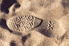 Shoe print in sand Royalty Free Stock Photo
