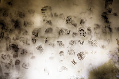 Shoe print. The wall of an abandoned building many shoe print stock images