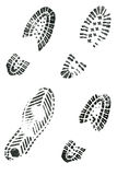 Shoe prints. Black shoe prints on white background Royalty Free Stock Photos