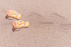 Shoe prints of flip flops at the beach Royalty Free Stock Image
