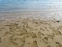 Shoe prints  on the sand Royalty Free Stock Images