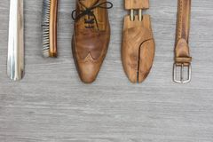Shoe products with a matching belt. Shoe products and a matching belt on a wooden background, topview Stock Photography