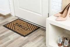Shoe rack and mat near door. In hallway royalty free stock photo
