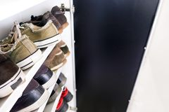 Shoe rack of sneakers shoes close up shelf. Shoe rack sneakers close up shelf royalty free stock image