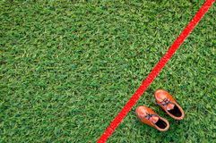 Shoe with red line drawing on grass floor Stock Photography