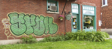 Shoe repair shop. With a Graffiti on the wall, located in St-Rose Laval, a Montreal,Quebec,Canada suburb Stock Photos