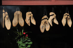 Shoe repair shop. Wooden footwear in the Berlin workshop Royalty Free Stock Images