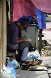 Shoe repairer at Siti Khadijah Market in in Kota Bharu, Kelantan, Malaysia, Asia Royalty Free Stock Photos