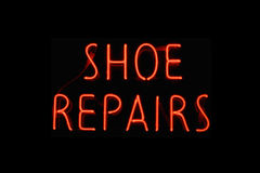 Shoe repairs neon sign Stock Photo