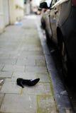 Shoe on the road. Rape Stock Photo