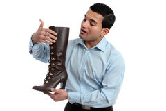 Shoe salesman showing women's boot Royalty Free Stock Photography