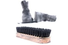 Shoe scrubber and boots. Military boots and brush isolated on white background Royalty Free Stock Photos