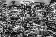 A shoe seller in a shop. In the Old city in Genoa Stock Images
