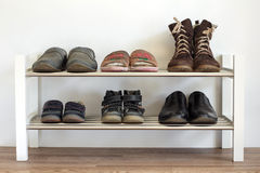 Shoe shelf at home Royalty Free Stock Images