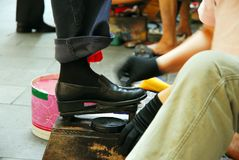 Shoe Shine. Getting a shoe shine spit and polish Stock Image