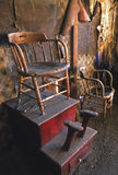 Shoe Shine Anybody. Old dilapidated shoe shine station dating to the late 1800's in Bodie, Ca Royalty Free Stock Image