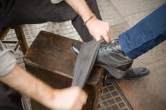 Shoe-shine boy Royalty Free Stock Images