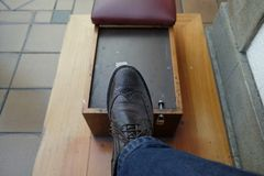 Shoe shine chair. Old work Royalty Free Stock Image