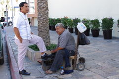 Shoe shine in Mexico. Mexican shoe-shine specialist at work on the streets of Mexico Stock Image